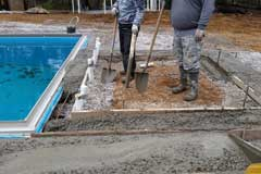 Pour concrete patio and construct any features