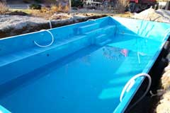 Deliver and position the fiberglass pool